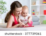 mother and baby are looking to... | Shutterstock . vector #377739361