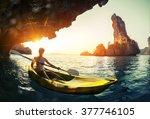 Young Lady Paddling The Kayak...