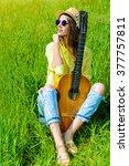 smiling romantic girl sitting... | Shutterstock . vector #377757811