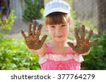 girl shows her dirty hands.   Shutterstock . vector #377764279