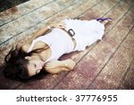 young woman laying over rusty... | Shutterstock . vector #37776955