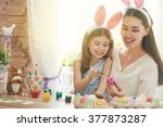 happy easter  a mother and her... | Shutterstock . vector #377873287