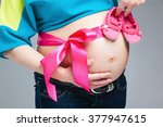 Pregnant Belly With Pink Ribbo...