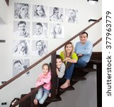 family photos on the wall.... | Shutterstock . vector #377963779
