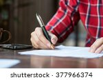 a man is writing signing on a... | Shutterstock . vector #377966374