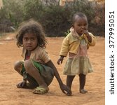 Small photo of Fianarantsoa, Madagascar - October 26, 2015: Two young Malagasy sisters on a dusty road in Fianarantsoa, poor African country.