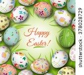 easter eggs on the grass.... | Shutterstock . vector #378028729
