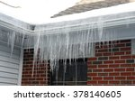 Icicle Hanging On House Roof