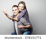young man carrying girlfriend... | Shutterstock . vector #378151771