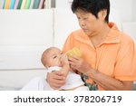 babysitter taking care baby at... | Shutterstock . vector #378206719