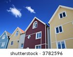 Four Colorful Houses With Blue...