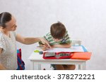 a young mother controls her six ... | Shutterstock . vector #378272221