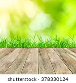 wooden floor  green grass on... | Shutterstock . vector #378330124