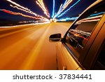 car driving fast in the night... | Shutterstock . vector #37834441