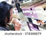 woman smelling the scented... | Shutterstock . vector #378388879