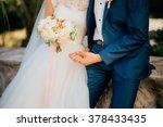 wedding bouquet in hands of the ... | Shutterstock . vector #378433435