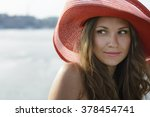 beautiful girl in a red hat... | Shutterstock . vector #378454741