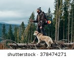 Hiker With Siberian Husky Dog...