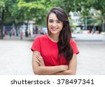 young woman in a red shirt with ... | Shutterstock . vector #378497341