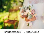 wedding bouquet in hands of the ... | Shutterstock . vector #378500815