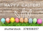 Small photo of Easter eggs and cute bunny in green grass. Festive decoration. Happy Easter!