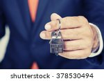real estate agent handing over... | Shutterstock . vector #378530494