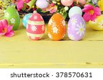 Easter Eggs And Flowers On A...