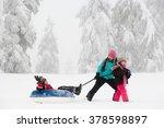 boy on inflatable toboggan | Shutterstock . vector #378598897