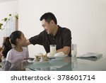 father and daughter sat at a... | Shutterstock . vector #378601714