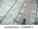 dangerous rope bridge over wild ... | Shutterstock . vector #37860877
