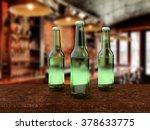 three green beer bottles on... | Shutterstock . vector #378633775