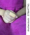Small photo of Child finger with an adhesive bandage