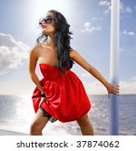 beautiful woman in red dress on ... | Shutterstock . vector #37874062