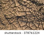 A Cracked And Dry Soil Due To...