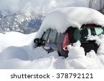 Car almost totally buried under a snow after a blizzard during the night at the alpin ski station - stock photo