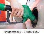 closeup of man pumping gasoline ... | Shutterstock . vector #378801157
