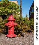 Red Fire Hydrant On Bark Groun...