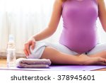 Pregnancy Yoga. Young Pregnant...