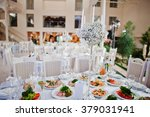 candlestick on table at wedding | Shutterstock . vector #379031941