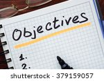 Small photo of Objectives concept written in a notebook