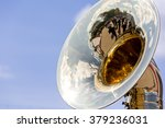 big brass tuba against blue sky ... | Shutterstock . vector #379236031