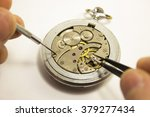 hands repair an old watch with...   Shutterstock . vector #379277434