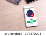 smartphone with shirt ecommerce ... | Shutterstock . vector #379573075