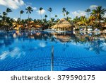 tropical swimming pool and palm ... | Shutterstock . vector #379590175
