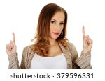 happy smiling woman pointing up. | Shutterstock . vector #379596331