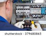 male electrician working on... | Shutterstock . vector #379680865