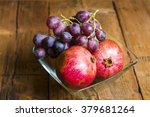 Pomegranates And Grapes On A...