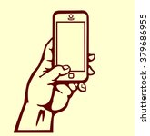 hand holding smartphone... | Shutterstock .eps vector #379686955