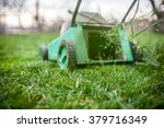 grass cutting with lawn mower.  | Shutterstock . vector #379716349