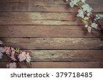 flowers on wooden background | Shutterstock . vector #379718485